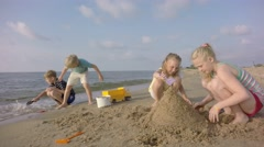Slow motion. Sand Toys On The Beach. Children build sand - stock footage