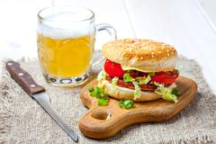 Homemade hamburger with fresh vegetables. Stock Photos