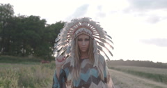 Native American Indian looking beautiful woman dancing with the sun. - stock footage