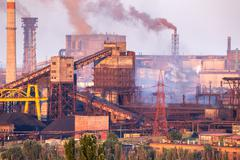 Industrial landscape in Ukraine. Steel factory with smog at sunset. Pipes - stock photo