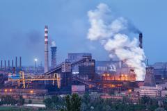 Metallurgical plant with white smoke at night. Steel factory with smokestacks Kuvituskuvat