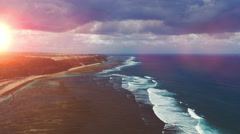 Sunset on the beach with ocean view and huge waves. Aerial view. Bali Indonesia - stock footage