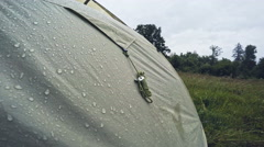Dew on a rainy day in a tent in a forest glade Stock Footage
