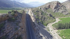 Flying Over Car Driving Through Mountain Road Tunnel Aerial Shot Stock Footage