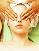 stock photo attractive lady getting spa treatment in salon, close up asian hands - stock photo