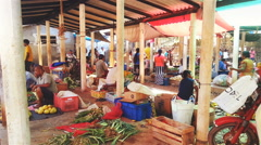 Local market in Sri Lanka, sellers sitting on ground with their goods. Poverty Stock Footage