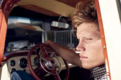 Caucasian man sitting in truck Kuvituskuvat