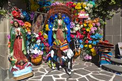 Shrine, statues and flowers Stock Photos