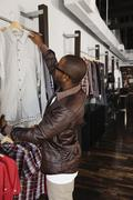 African American man shopping in clothing store Stock Photos