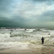 People surfing in stormy ocean Kuvituskuvat