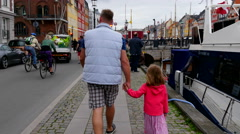 A man walking with a girl in a city area Stock Footage