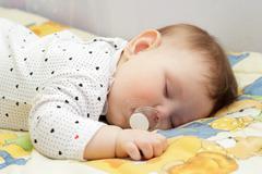 Little newborn baby girl sleeping Stock Photos