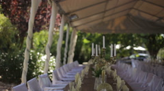 Arranged dining tables at garden wedding Stock Footage