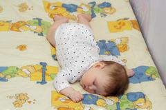 Little newborn baby girl sleeping Stock Photos