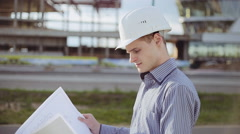 Architect on construciton site check documents and business workflow Stock Footage
