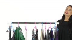 Portrait of beautiful young smiling woman near rack with hangers. Shopping - stock footage
