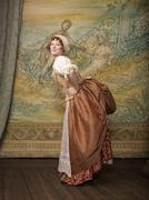 Actress dressed in old-fashioned costume on stage Stock Photos