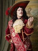 Actor dressed in old-fashioned costume on stage Stock Photos