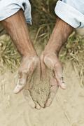 African American farmer checking dirt in field Kuvituskuvat