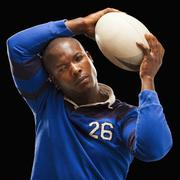 African American athlete holding rugby ball Stock Photos