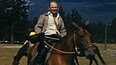 Canada  1948: man riding a horse at Jasper Park, Alberta Stock Footage