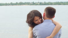 Sweet Young Couple Cuddling by the sea. Stock Footage