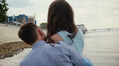 Couple In Love Cuddling by the river. Stock Footage