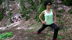 Fit woman exercising outdoors. Forest workout spring Stock Footage