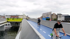 On the walk- and bike bridge in Copenhagen commuters and tourists are happy Stock Footage