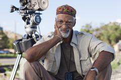 African American director near film camera Stock Photos