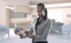 African American businesswoman using digital display Stock Photos