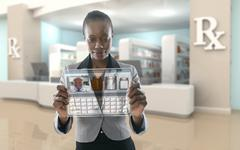 African American businesswoman using digital display in pharmacy Stock Photos