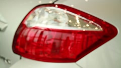 Rear car lheadlight blur-focus Stock Footage