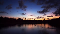 Sunset over the lake near the golf course, tropical resort Stock Footage