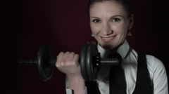 4k Shot of a Business Woman in Studio Lifting a Bodybuilding Weight Stock Footage