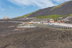 Mount Etna with car parking for tourists visiting the vulcano, Sicily Stock Photos