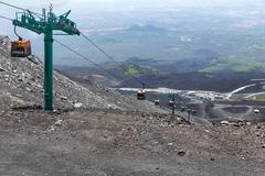 Cable car tot top of Mount Etna at Sicily, Italy - stock photo