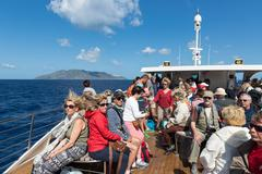 Cruise ship with tourists visiting the Aeolian Islands at Sicily, Italy - stock photo