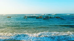 Group of fishermen on small boats fishing in ocean, early morning, sunny day Stock Footage