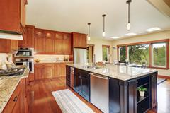 Small kitchen area with open floor plan, view of dining room . Kitchen room h - stock photo