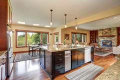 Small kitchen area with open floor plan, view of living room. Kitchen room ha - stock photo