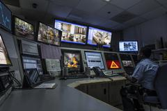 African American security officer working in control room Stock Photos