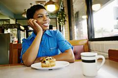 African American woman smiling in restaurant Kuvituskuvat