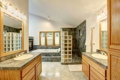 Master bathroom interior with tile flooring and modern cabinets with twin sin Stock Photos