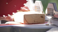 Extreme close up of a man using Chop Saw outside on a construction site - stock footage