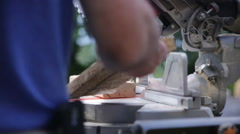 Man using Chop Saw outside on a construction site - stock footage