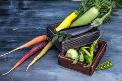 Composition of vegetables in a wooden boxes Stock Photos
