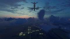 Airliner landing approach in night sky above illuminated suburbs 4K Stock Footage