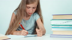 Close up portrait schoolgirl learning lessons on white background Stock Footage