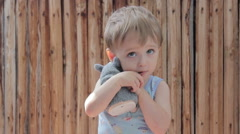 Boy child hugging a soft toy and smiling. Stock Footage
